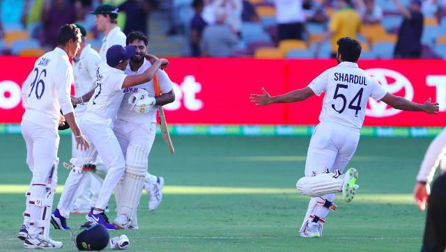 Rishabh Pant celebrates with teammates after guiding the visitors to a historic win at the Gabba on the final day of the fourth Test. AP