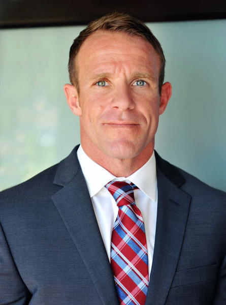 FILE - This 2018 file photo provided by Andrea Gallagher shows her husband, Navy SEAL Edward Gallagher, who has been charged with murder in the 2017 death of an Iraqi war prisoner. Lawyers on Gallagher's defense team told The Associated Press that emails they and a reporter received from military prosecutors in the case contained tracking software. (Andrea Gallagher via AP, File)