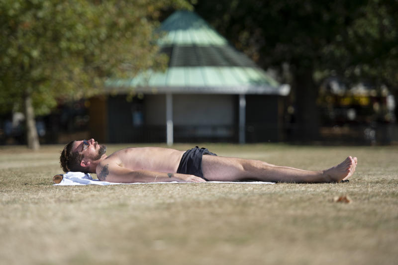 A sunbather in Hyde Park, London, as temperatures are expected to soar to 26C in some parts of the country this weekend. (Photo by David Mirzoeff/PA Images via Getty Images)