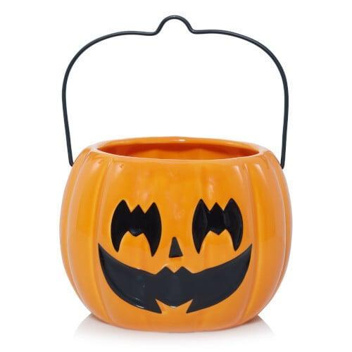 <p>This <span>Pumpkin Jar Candle Holder</span> ($22) makes us nostalgic for our old trick-or-treating bags.</p>