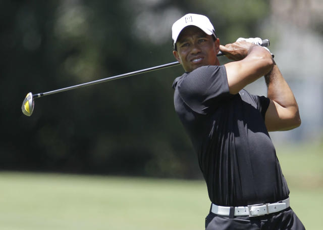 Tiger Woods hits from the second fairway during the second round of the Players Championship golf tournament at TPC Sawgrass, Friday, May 11, 2012, in Ponte Vedra Beach, Fla. (AP Photo/John Raoux)