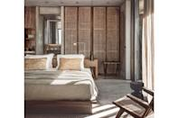 """<p><strong>Crete, Greece</strong></p> <p>It takes guts to step outside the white-on-white motif of so many hotels in Greece, which is what makes this naturals-forward newcomer on Crete's northwest shore such a stunning arrival. With modernist lines from Greek architecture firm <a href=""""https://www.k-studio.gr/"""" rel=""""nofollow noopener"""" target=""""_blank"""" data-ylk=""""slk:K-Studio"""" class=""""link rapid-noclick-resp"""">K-Studio</a> in collaboration with <a href=""""https://lambsandlions.com/"""" rel=""""nofollow noopener"""" target=""""_blank"""" data-ylk=""""slk:Lambs and Lions Berlin"""" class=""""link rapid-noclick-resp"""">Lambs and Lions Berlin</a>, a village of concrete-and-timber-lined boxes creates soothing spaces in 106 guest rooms that get even more zen in the interior design and styling hands of Lambs and Lions and <a href=""""https://annabellkutucu.com/"""" rel=""""nofollow noopener"""" target=""""_blank"""" data-ylk=""""slk:Annabell Kutucu"""" class=""""link rapid-noclick-resp"""">Annabell Kutucu</a>. The feeling is one of shady, cool retreat from the Greek sun, rather than feeling bleached out by it—a brilliant innovation. Rates start at $318; <a href=""""https://casacook.com/"""" rel=""""nofollow noopener"""" target=""""_blank"""" data-ylk=""""slk:casacook.com"""" class=""""link rapid-noclick-resp"""">casacook.com</a>.</p>"""