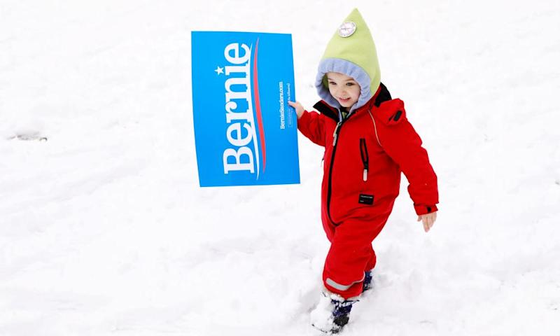 Katherine Bonavita, four, carries a sign ahead of Bernie Sanders' rally.