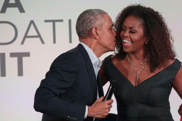 PHOTO: Former President Barack Obama gives his wife Michelle a kiss as they close the Obama Foundation Summit together on the campus of the Illinois Institute of Technology in Chicago, Oct. 29, 2019. (Scott Olson/Getty Images)