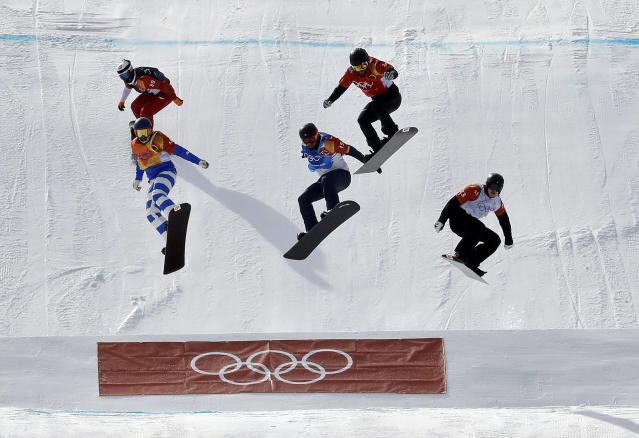 <p>From left; Mateusz Ligocki, of Poland, Emanuel Perathoner, of Italy, Nick Baumgartner, of the United States,Martin Noerl, of Germany, and Anton Lindfors, of Finland, run the course during the men's snowboard cross quarterfinal at Phoenix Snow Park at the 2018 Winter Olympics in Pyeongchang, South Korea, Thursday, Feb. 15, 2018. (AP Photo/Lee Jin-man) </p>