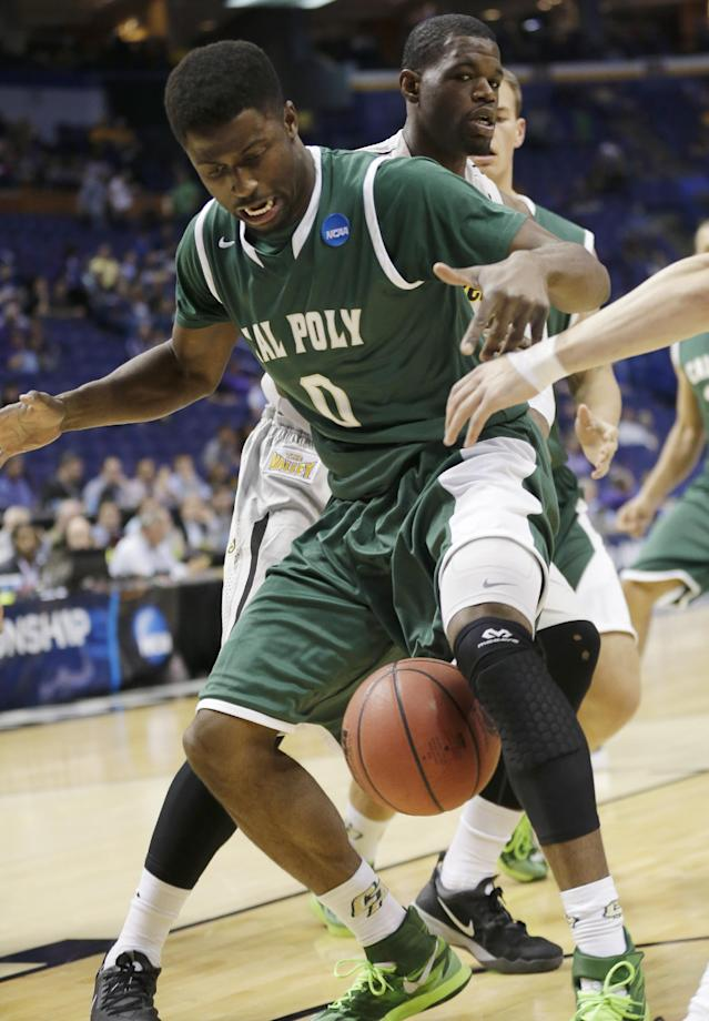 Cal Poly guard/forward Dave Nwaba (0) loses the ball as Wichita State forward Chadrack Lufile (0) defends during the first half of a second-round game in the NCAA college basketball tournament Friday, March 21, 2014, in St. Louis. (AP Photo/Charlie Riedel)