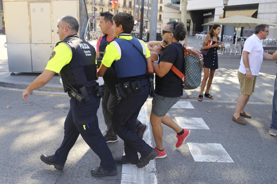 <p>An injured person is carried in Barcelona, Spain, Aug. 17, 2017 after a white van jumped the sidewalk in the historic Las Ramblas district, crashing into a summer crowd of residents and tourists and injuring several people, police said. (Oriol Duran/AP) </p>