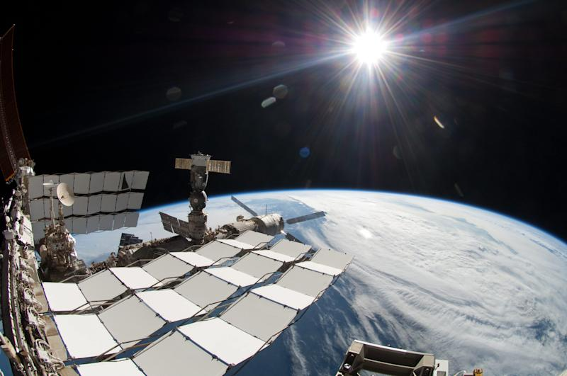 This undated file image provided by the European Space Agency ESA on Wednesday April 3, 2013   shows the International Space Station in the sunlight. A $2 billion cosmic ray detector on the International Space Station has found the footprint of something that could be dark matter, the mysterious substance that is believed to hold the cosmos together but has never been directly observed, scientists say. But the first results from the Alpha Magnetic Spectrometer, known by its acronym AMS, are almost as enigmatic as dark matter itself. They show evidence of new physics phenomena that could be the strange and unknown dark matter or could be energy that originates from pulsars, scientists at the European particle physics laboratory near Geneva announced Wednesday April 3, 2013. (AP Photo/NASA/European Space  Agency ESA. Keystone)