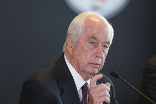 Penske Corporation Chairman Rodger Penske gestures during a news conference at Indianapolis Motor Speedway in Indianapolis Monday, Nov. 4, 2019. Indianapolis Motor Speedway and the IndyCar Series were sold to Penske Entertainment Corp. in a stunning move Monday that relinquishes control of the iconic speedway from the Hulman family after 74 years. (AP Photo/AJ Mast)