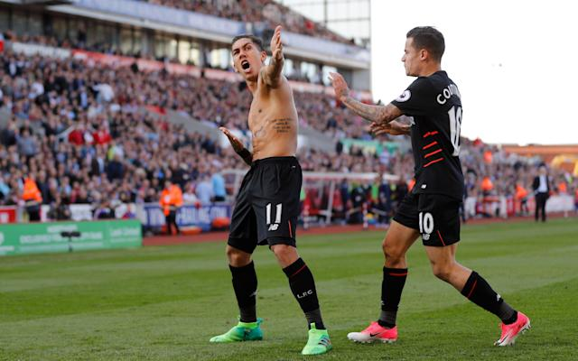 <span>Roberto Firmino celebrates with Coutinho after the pair delivered an incredible comeback against Stoke</span>