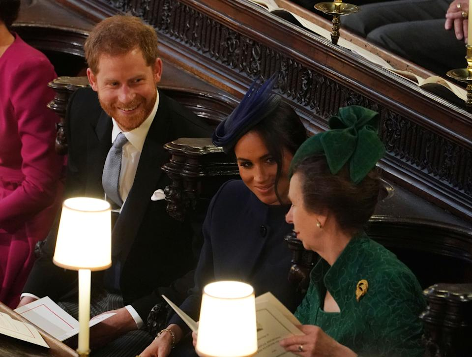 WINDSOR, ENGLAND - OCTOBER 12: Prince Harry, Duke of Sussex, Meghan, Duchess of Sussex and Princess Anne, Princess Royal attend the wedding of Princess Eugenie of York and Mr. Jack Brooksbank at St. George's Chapel on October 12, 2018 in Windsor, England. (Photo by Owen Humphreys - WPA Pool/Getty Images)