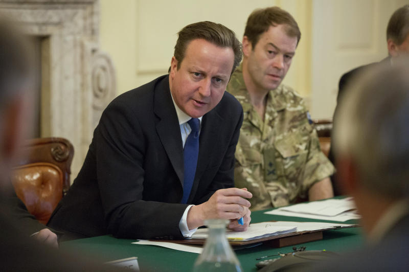 British Prime Minister David Cameron speaks as he chairs the Government's emergency meeting at 10 Downing Street in central London to address the developing flood situation, Wednesday Feb. 12, 2014. Troops have been deployed to help in the flood effort as much of the country is bracing itself for more extreme weather over the coming days. Major General Patrick Sanders at right. (AP Photo/Neil Hall, PA) UNITED KINGDOM OUT - NO SALES - NO ARCHIVES