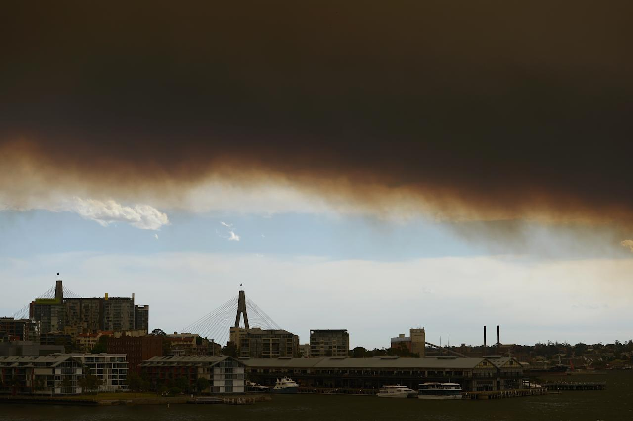 SYDNEY, AUSTRALIA - OCTOBER 17: Smoke covers the ANZAC Bridge and surrounding areas as bushfires rage across NSW on October 17, 2013 in Sydney, Australia. The brushfires rage in the western Sydney suburbs of Springwood, Winmalee and Lithgow. (Photo by Brett Hemmings/Getty Images)