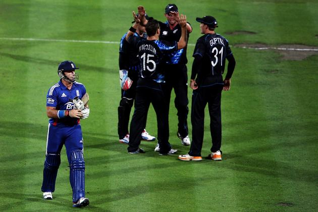 HAMILTON, NEW ZEALAND - FEBRUARY 12:  Nathan McCullum of New Zealand celebrates with the team after claiming the wicket of Michael Lumb of England during the international Twenty20 match between New Zealand and England at Seddon Park on February 12, 2013 in Hamilton, New Zealand.  (Photo by Hannah Johnston/Getty Images)