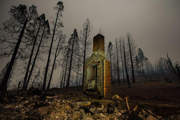 "The smoldering remains of a structure are seen along Auberry Road in Fresno County, where the Creek fire burned through. <span class=""copyright"">(Kent Nishimura / Los Angeles Times)</span>"