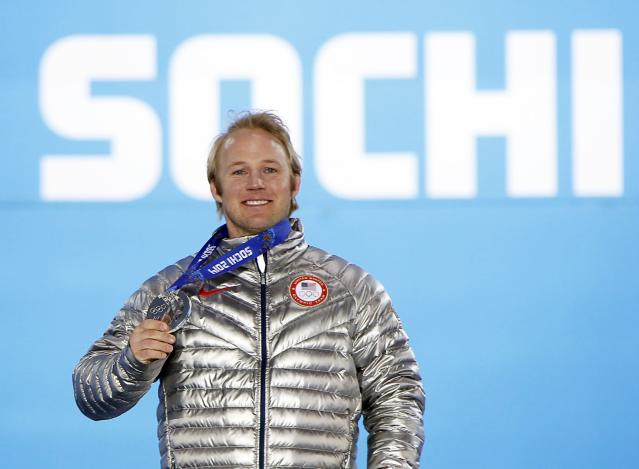 Silver medallist Andrew Weibrecht of the U.S. poses during the victory ceremony for the men's alpine skiing Super-G competition at the 2014 Sochi Winter Olympics February 16, 2014. REUTERS/Eric Gaillard (RUSSIA - Tags: SPORT SKIING OLYMPICS)