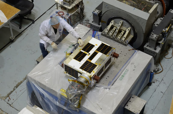 A view of Canada's asteroid-hunting NEOSSat satellite from above. The $25 million satellite is about the size of a suitcase and designed to seek out large asteroids near Earth.