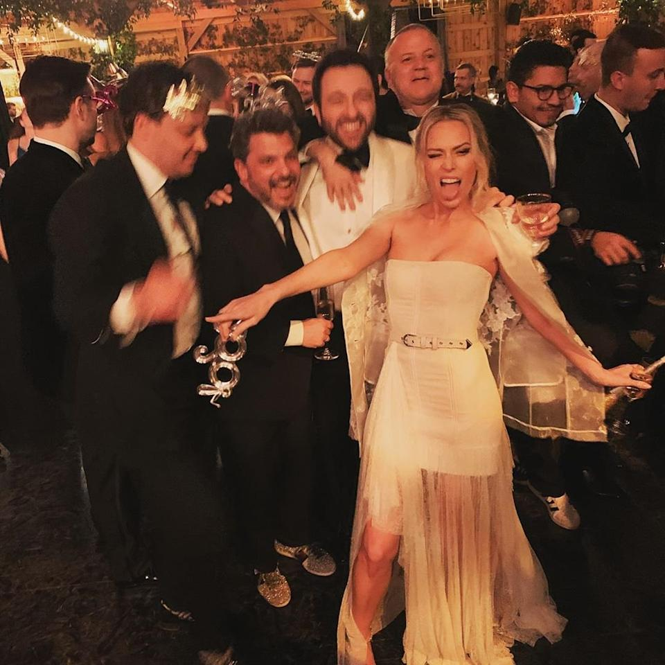 """What better way to ring in the New Year than with a new ring? The Bumble entrpreneur kicked off 2020 with a glamorous Nashville <a href=""""https://people.com/style/erin-foster-marries-simon-tikhman-new-years-eve-ceremony/"""">wedding to her businessman fiancé</a> on New Year's Eve.  The couple, who started dating in August 2018, said """"I do"""" in front of their closest family and friends, including the bride's dad David Foster, his wife Katharine McPhee, and pals Kate Hudson and Rachel Zoe.  """"I got to marry the love of my life, and hopefully will never have to look at a seating chart again for as long as I shall live,"""" Foster joked on <a href=""""https://www.instagram.com/p/B60_4x8FOhi/"""">Instagram</a>."""