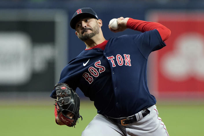Boston Red Sox starting pitcher Martin Perez delivers to the Tampa Bay Rays during the first inning of a baseball game Friday, July 30, 2021, in St. Petersburg, Fla. (AP Photo/Chris O'Meara)