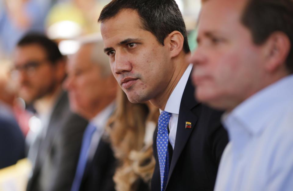 FILE - In this Feb. 21, 2020 file photo, opposition leader Juan Guaido meets with union workers and supporters in Caracas, Venezuela. A British judge on Thursday July 2, 2020, refused to give Venezuela control of over $1 billion in gold sitting in a Bank of England vault, ruling that it is unlawful to give it to the President Nicolas Maduro since Britain does not recognize him as the president. Maduro has demanded the gold to help his cash-starved nation fight the coronavirus pandemic. (AP Photo/Ariana Cubillos, File)