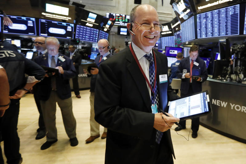 Trader Gordon Charlop smiles as he works on the floor of the New York Stock Exchange, Wednesday, Sept. 4, 2019. Stocks are opening higher on Wall Street following big gains in Asia as Hong Kong's government withdrew a controversial extradition law that set off three months of protests there. (AP Photo/Richard Drew)