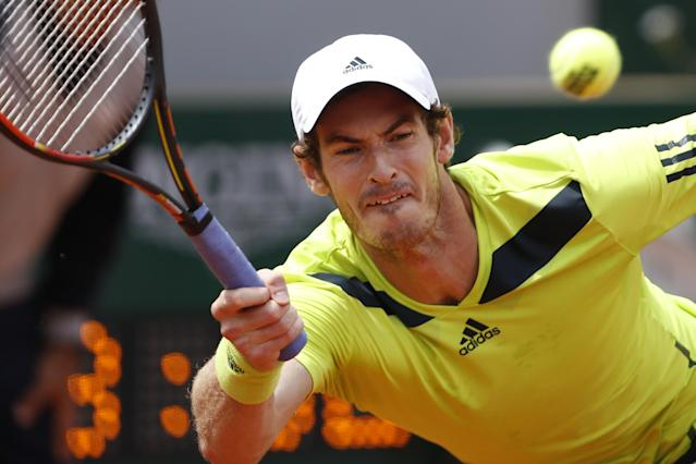 Britain's Andy Murray returns the ball during the third round match of the French Open tennis tournament against Germany's Philipp Kohlschreiber at the Roland Garros stadium, in Paris, France, Sunday, June 1, 2014. Murray won in five sets 3-6, 6-3, 6-3, 4-6, 12-10. (AP Photo/Darko Vojinovic)