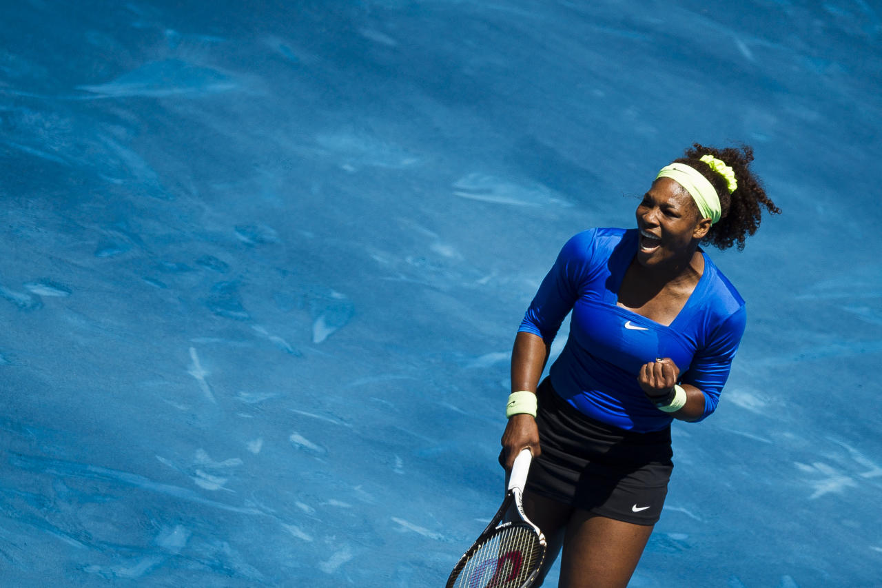 Serena Williams from U.S. celebrates during the Madrid Open tennis tournament match against Caroline Wozniacki from Denmark, in Madrid, Thursday, May 10, 2012. (AP Photo/Daniel Ochoa de Olza)
