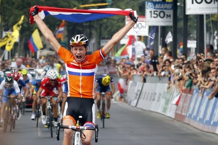 Van der Poel of Netherlands celebrates as he crosses finish line to win men's junior road race at UCI Road World Championships in Florence