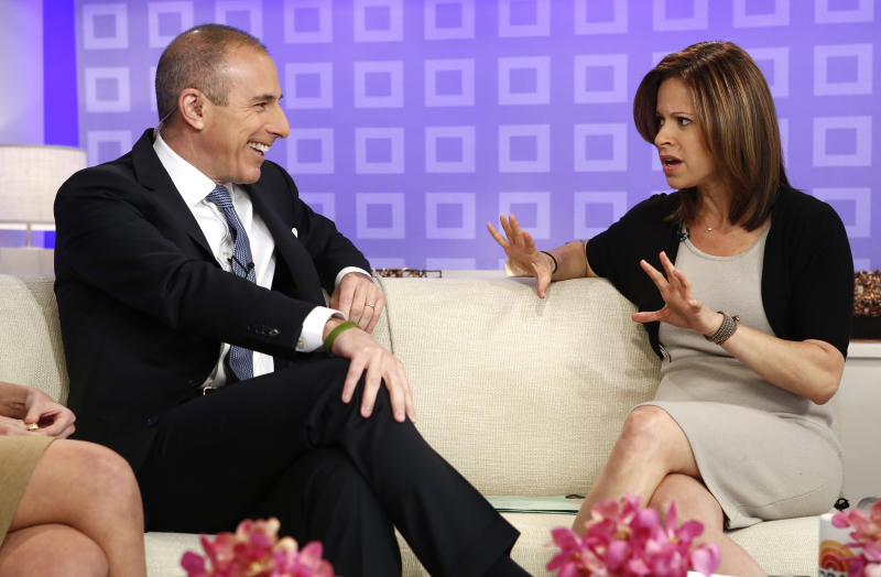 "This image released by NBC shows co-host Matt Lauer, left, talking with weekend correspondent Jenna Wolfe as she announces that she is pregnant during the ""Today"" show in New York on Wednesday, March 27, 2013. Wolfe, who is expecting a baby in August with her partner, NBC News foreign correspondent Stephanie Gosk, will chronicle her pregnancy experience on a blog. (AP Photo/NBC, Peter Kramer)"