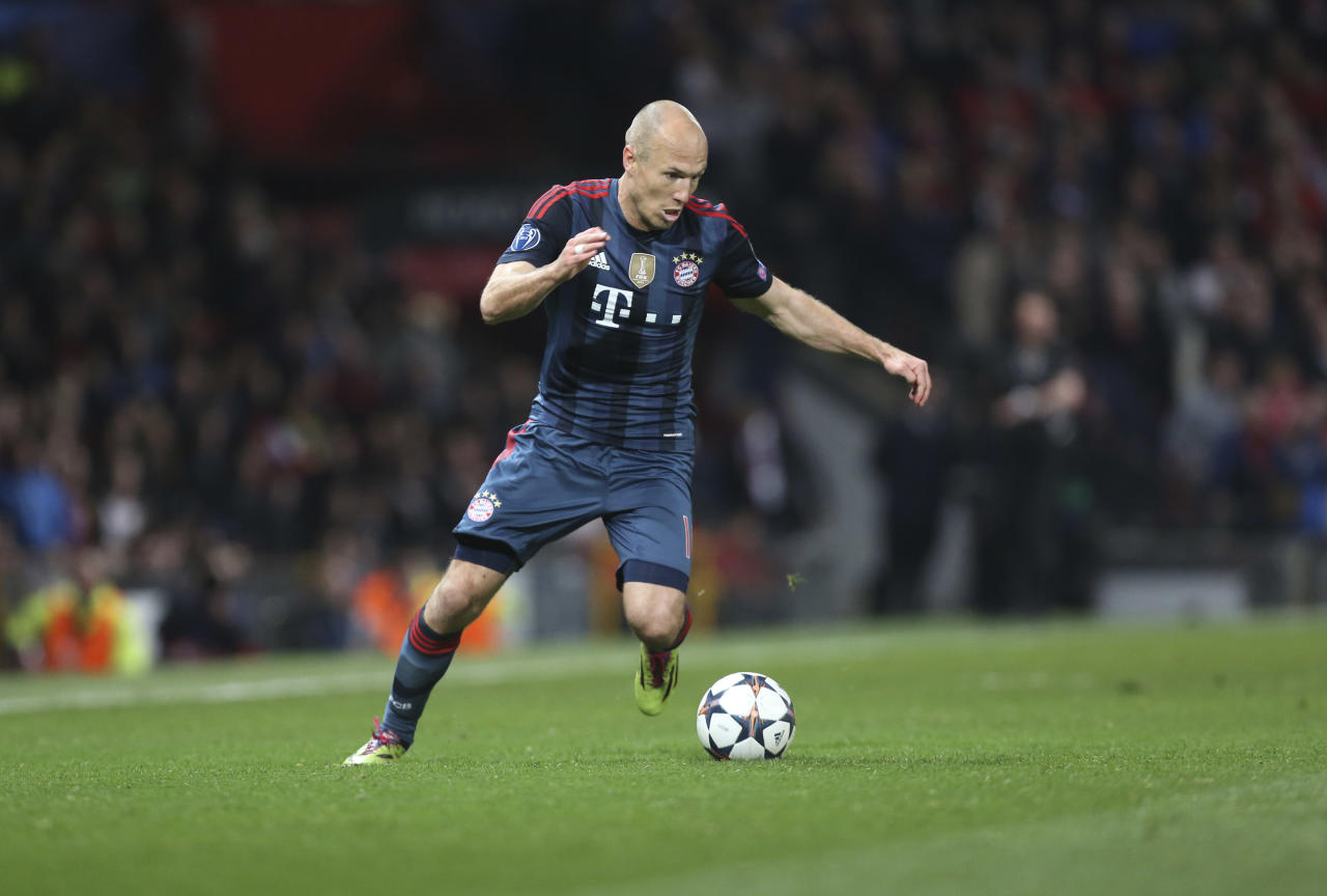 Bayern's Arjen Robben goes with the ball during the Champions League quarterfinal first leg soccer match between Manchester United and Bayern Munich at Old Trafford Stadium, Manchester, England, Tuesday, April 1, 2014.(AP Photo/Jon Super)