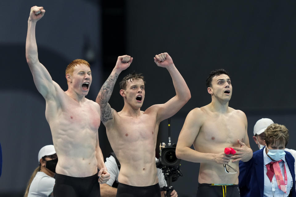 Britain's men's 4x200-meters relay team of Tom Dean, James Guy, and Matthew Richards celebrate after winning the gold medal at the 2020 Summer Olympics, Wednesday, July 28, 2021, in Tokyo, Japan. (AP Photo/Martin Meissner)