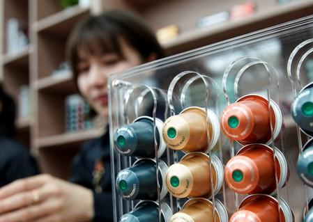 Starbucks labeled single-serve coffee capsules for Nespresso coffee makers are displayed after a news conference of Nestle start selling Starbucks-branded coffee in China, in Shanghai