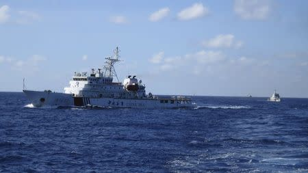 Chinese coastguard ships give chase to Vietnamese coastguard vessels after they came within 10 nautical miles of the Haiyang Shiyou 981, known in Vietnam as HD-981, oil rig in the South China Sea