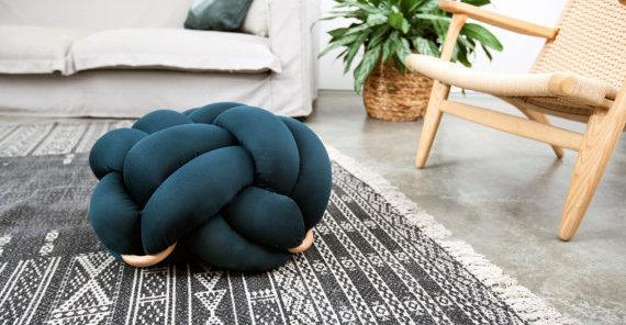 "Shop this floor cushion at <a href=""https://www.etsy.com/listing/490244697/medium-knot-floor-cushions-in-dark-green?utm_medium=editorial_internal&utm_source=etsy_blog&utm_campaign=home_decor_trend_guide&utm_content=curalate&crl8_id=8c5e92ad-e05f-446c-a95e-6e5880f0c526"" target=""_blank"">Etsy, $265</a>."