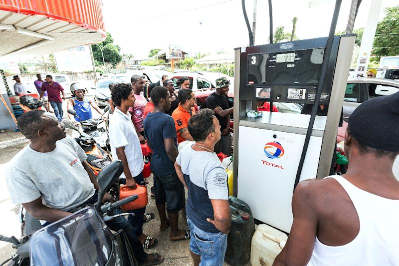Queues formed at petrol stations in the French overseas territory of Guiana as people tried to stock up on fuel ahead of a general strike on Monday