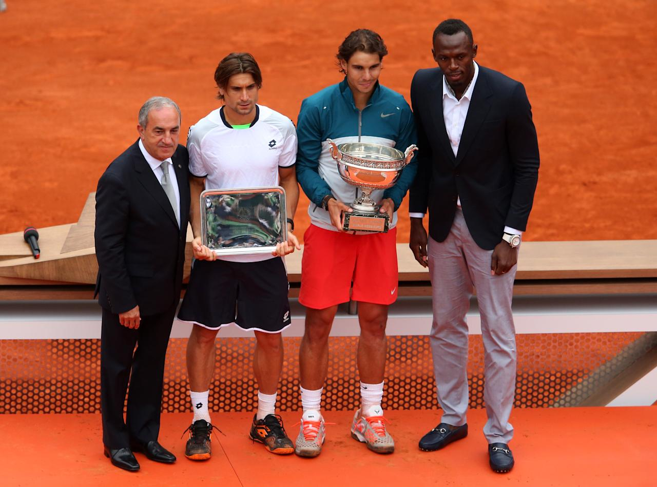 PARIS, FRANCE - JUNE 09: (L-R) President of the International Tennis Federation Francesco Bitti Ricci, runner up David Ferrer of Spain, winner Rafael Nadal of Spain and Olympic champion Usain Bolt pose after the mens' singles final during day fifteen of the French Open at Roland Garros on June 9, 2013 in Paris, France.  (Photo by Julian Finney/Getty Images)