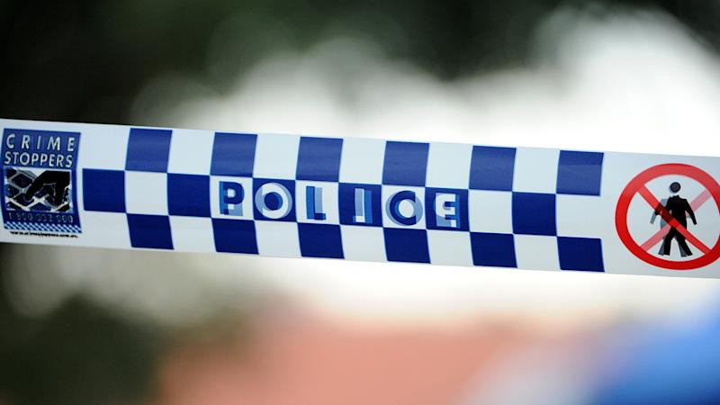 A woman was arrested after man has been found shot dead in a ute tray at Dundurrabin, NSW.
