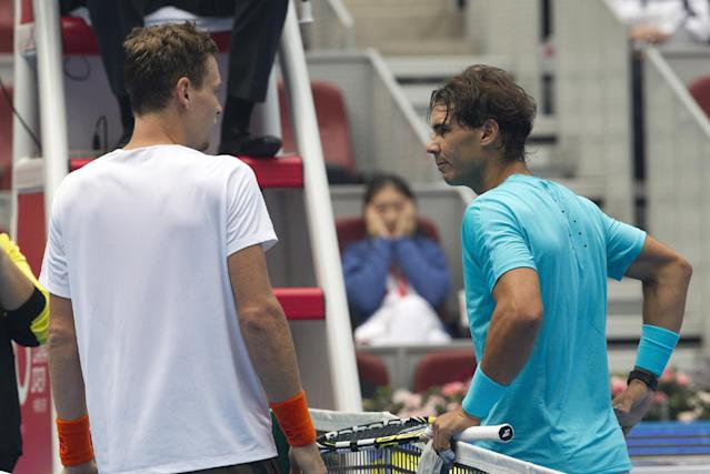 Tomas Berdych of the Czech Republic, left, talks with Rafael Nadal of Spain after he retired from the semifinal match at the China Open tennis tournament at the National Tennis Stadium in Beijing, China Saturday, Oct. 5, 2013. Nadal was a break up at 4-2 in the opening set of their semifinal match when Berdych retired soon after taking an injury timeout. (AP Photo/Andy Wong)