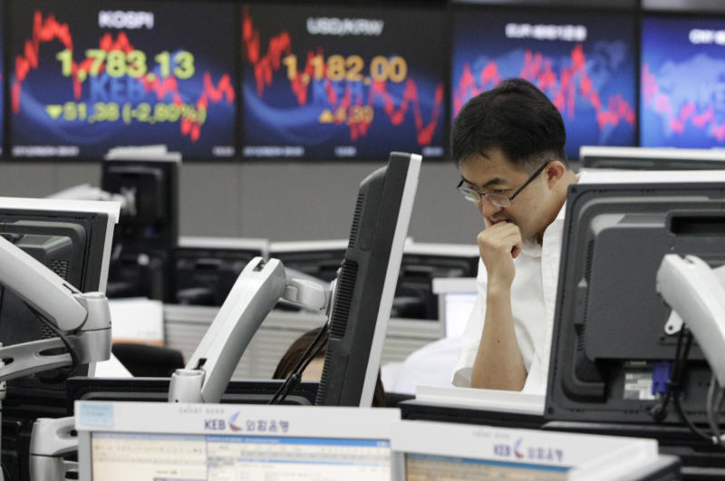 A currency trader workers at the foreign exchange dealing room of the Korea Exchange Bank headquarters in Seoul, South Korea, Monday, June 4, 2012. The Korea Composite Stock Price Index fell 2.80 percent, or 51.38, to close at 1,783.13. (AP Photo/Ahn Young-joon)