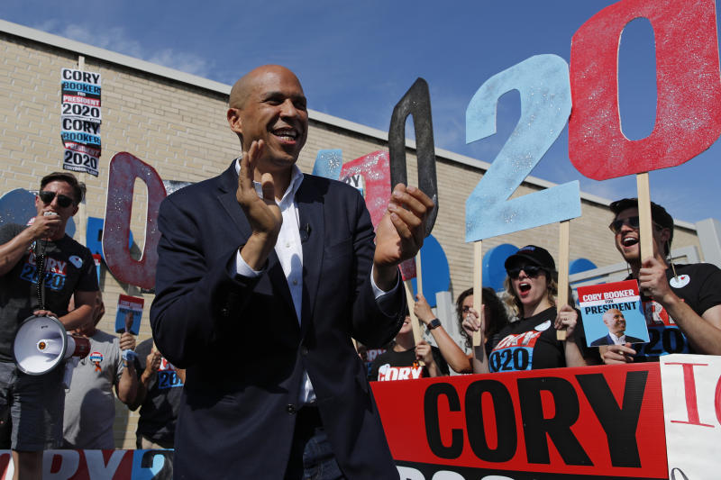 In this Aug. 9, 2019 photo, Democratic presidential candidate Sen. Cory Booker speaks to supporters before the Iowa Democratic Wing Ding at the Surf Ballroom in Clear Lake, Iowa. Months after Cory Booker took office as mayor of Newark, N.J. in 2006, he enabled his law partner to take power at the nonprofit that supplied water to 500,000 state residents. During the ensuing seven years, allies of the two-term mayor wasted millions of dollars in public money at the Newark Watershed Conservation and Development Corporation. Booker says he was unaware of the corruption, which ultimately destroyed the nonprofit created to protect one of Newark's most valuable assets.  (AP Photo/John Locher)