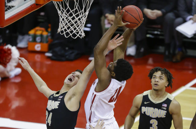 Wisconsin's Khalil Iverson (21) shoots against Purdue's Grady Eifert (24) and Carsen Edwards during the first half of an NCAA college basketball game Friday, Jan. 11, 2019, in Madison, Wis. (AP Photo/Andy Manis)