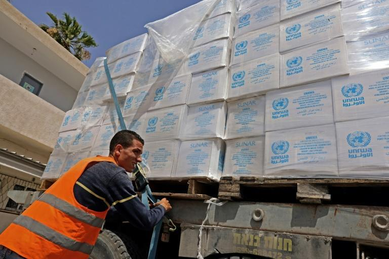 A truck loaded with humanitarian aid passes through the Kerem Shalom crossing into Rafah in the southern Gaza Strip