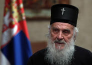 FILE - In this March 15, 2020, file photo, Serbian Patriarch Irinej speaks during a statement with Serbian President Aleksandar Vucic in Belgrade, Serbia. Serbia's Orthodox Church said Friday, Nov. 20, 2020, the leader, Patriarch Irinej, has died after testing positive for the coronavirus. He was 90.(AP Photo/Darko Vojinovic, File)