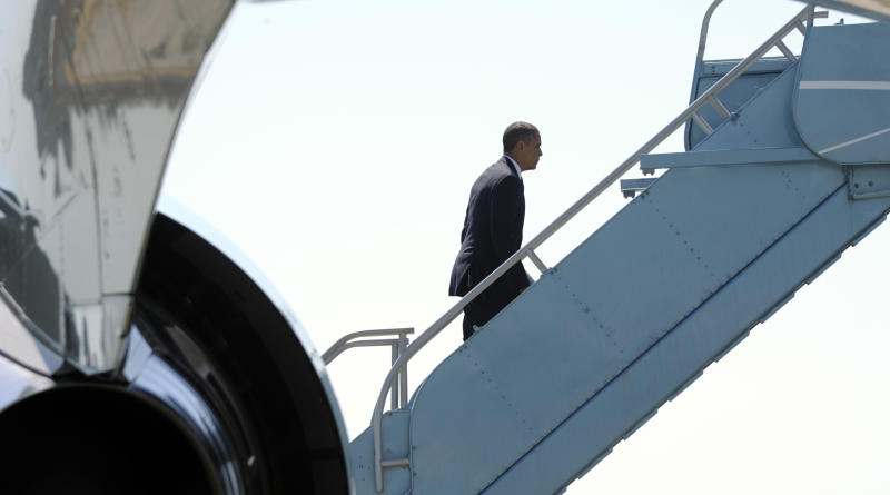 President Barack Obama walks up the steps of Air Force One at San Francisco International Airport in San Francisco, Monday, July 23, 2012. Obama is heading to Reno, Nev., to give remarks at the 113th National Convention of the VFW. (AP Photo/Susan Walsh)