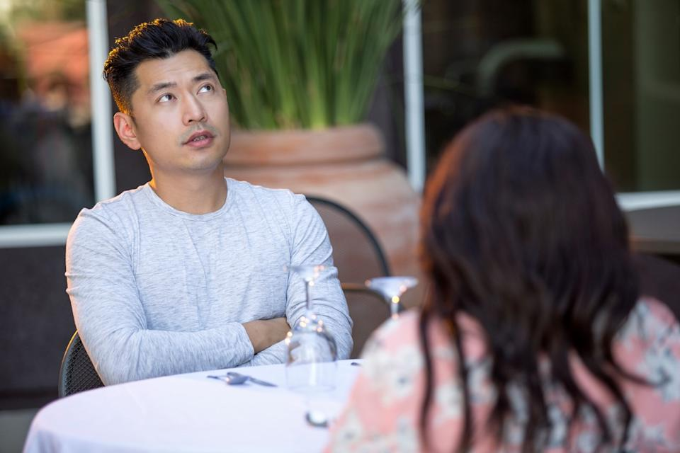 man clearly bored in conversation