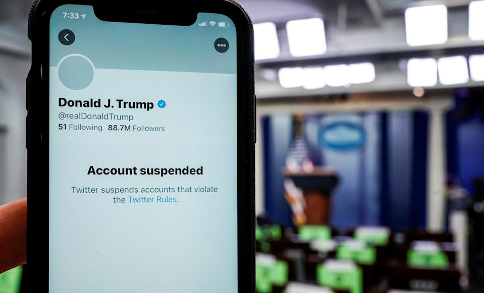 "The suspended Twitter account of President Donald Trump on a smartphone, reading ""Account suspended"""
