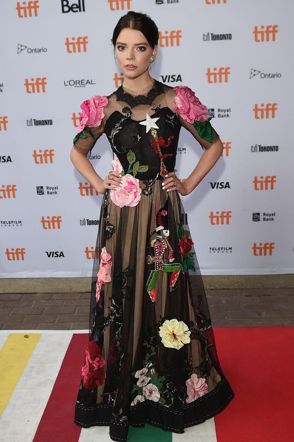 <p>Anya wore a floral Dolce &amp; Gabbana gown with that must-have accessory - a wand!</p>