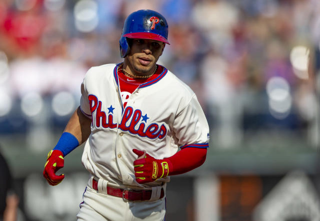 Philadelphia Phillies' Cesar Hernandez (16) runs the bases after hitting a home run in the first inning of a baseball game against the Atlanta Braves, Sunday, Sept. 30, 2018, in Philadelphia. (AP Photo/Laurence Kesterson)