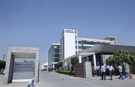 People walk in front of the HCL Technologies Ltd office at Noida