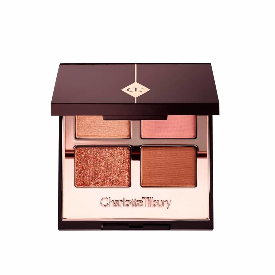 """How pretty is this golden palette from Charlotte Tilbury? It's a small but luxe-feeling pick for a gift, but also equally great to keep for yourself for touch-ups while traveling. <em>—E.P.</em> $53, Sephora. <a href=""""https://www.sephora.com/product/luxury-eyeshadow-palette-P433523"""">Get it now!</a>"""